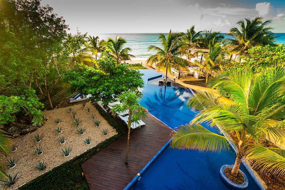 Overview of infinity pool and beach, Le Reve Hotel, Riviera Maya, Quintana Roo, Mexico
