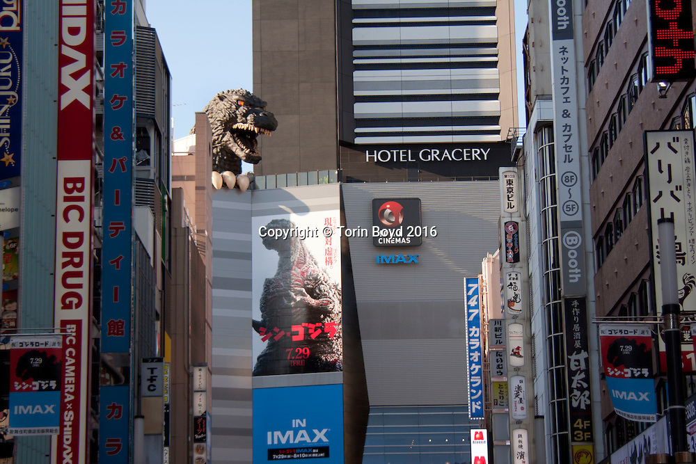 "July 30, 2016, Tokyo, Japan: This is a giant Godzilla head in the Shinjuku district that towers 52 meters (170 ft.) above the street. It is part of a movie theater and entertainment complex owned by Toho Co. Ltd., the maker of the Godzilla film franchise. The street leading up to this complex is called ""Godzilla Road"", located in one of the biggest entertainment districts of Tokyo known as Kabuki-cho. This neighborhood is very similar to New York's Times Square as up until recently, it was a sleazy red light district. Now it's being redeveloped into a popular tourist destination that's clean and family friendly. The latest Godzilla film which is currently playing here is entitled ""Godzilla Resurgence"" (Japanese title ""Shin Godzilla""). It was released nationwide in Japan on July, 29, 2016 and is the 29th film in Toho's Godzilla franchise. The first Godzilla film was released by Toho in 1954. (Torin Boyd/Polaris)."