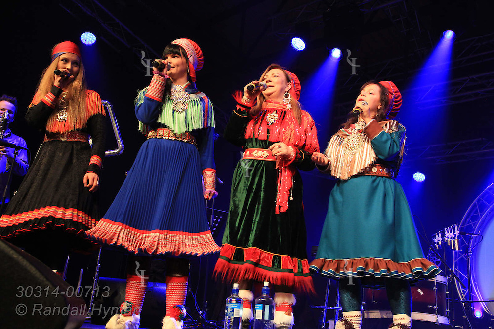 Singers Sofia Jannok of Sweden, Sara Marielle Gaup Beaska and Mari Boine of Norway, and Ulla Pirttijärvi of Finland (left to right) perform during Inga Jusso memorial concert at the Sami Easter Festival in Kautokeino, Finnmark, Norway.