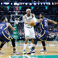 04 January 2013: Boston Celtics small forward Paul Pierce (34) drives past Indiana Pacers small forward Paul George (24) and Indiana Pacers point guard D.J. Augustin (14) during the Boston Celtics 94-75 victory over the Indiana Pacers at the TD Garden, Boston, Massachusetts, USA.