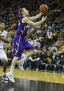 January 12 2010: Northwestern Wildcats guard Alex Marcotullio (4) puts up a shot during the second half of an NCAA college basketball game at Carver-Hawkeye Arena in Iowa City, Iowa on January 12, 2010. Northwestern defeated Iowa 90-71.