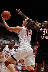 February 24, 2011; Stanford, CA, USA;  Stanford Cardinal forward Kayla Pedersen (14) shoots past Oregon St. Beavers forward El Sara Greer (34) during the first half at Maples Pavilion.