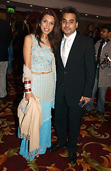 Actor AMEET CHANA and his wife at the 10th Anniversary Asian Business Awards 2006 at the London Grosvenor Hotel Park Lane, London on 19th April 2006.<br />