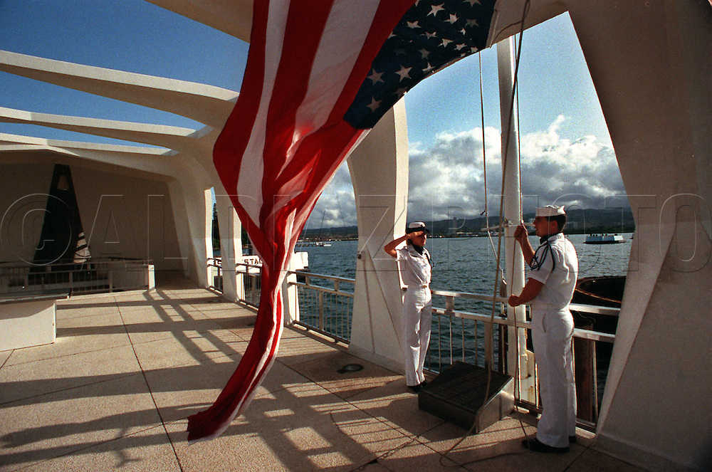 Raising the flag at the Arizona Memorial at Pearl Harbor on the 50th anniversary of the Japanese attack.