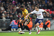 Shawn McCoulsky of Newport County tires to keep the ball from Harry Winks of Tottenham Hotspur during the The FA Cup fourth round replay match between Tottenham Hotspur and Newport County at Wembley Stadium, London, England on 6 February 2018. Picture by Toyin Oshodi.