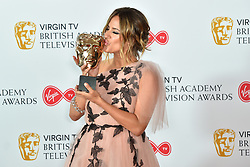 Caroline Flack kisses the BAFTA award for Reality and Constructed Factual for Love Island at the Virgin TV British Academy Television Awards 2018 held at the Royal Festival Hall, Southbank Centre, London.