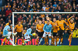 MANCHESTER, ENGLAND - Saturday, November 28, 2009: Manchester City's Carlos Tevez takes a free-kick against Hull City during the Premiership match at the City of Manchester Stadium. (Photo by David Rawcliffe/Propaganda)