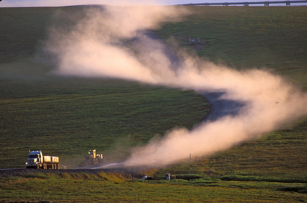A large truck leaves a huge dust trail behind as it winds its way to the North Slope on the Dalton Hwy.