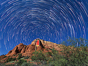 Star trails over the Chapel of the Holy Cross, Sedona, Arizona.