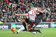 Sunderland midfielder Lee Cattermole stops Liverpool midfielder Emre Can shot during the Barclays Premier League match between Sunderland and Liverpool at the Stadium Of Light, Sunderland, England on 30 December 2015. Photo by Simon Davies.
