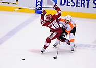 Dec. 3 2011; Glendale, AZ, USA; Phoenix Coyotes forward Patrick O'Sullivan (18) and Philadelphia Flyers forward Danny Briere (48) battle for the puck during the third period at Jobing.com Arena. The Flyers defeated the Coyotes 4-2. Mandatory Credit: Jennifer Stewart-US PRESSWIRE.