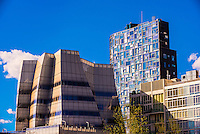 IAC Building by Frank Gehry (on left) and a 23 story residential tower in Chelsea by French architect Jean Nouvel.  lower west side of Manhattan, New York City, New York USA.