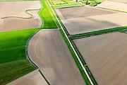 Nederland, Zeeland, Gemeente Sluis, 09-05-2013; omgeving IJzendijke, Oranjedijk,Mauritspolder en Oranjepolder, zicht op de Generale Prins Willempolder, genoemd naar de namen die in de tachtigjarige oorlog een rol speelden, onderdeel van zeventiende-eeuwse bedijkingsprojecten na de Vrede van Muenster in 1648.<br /> Polders  in Zeeuws-Vlaanderen,  in Zeeuws-Vlaanderen,  the south-west part of the province of Zeeland. The polders are named after the royal commanders of the army during the Eighty Years' War, dams projects made after the peace of Muenster (1648). <br /> luchtfoto (toeslag op standard tarieven);<br /> aerial photo (additional fee required);<br /> copyright foto/photo Siebe Swart.