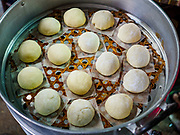 "12 FEBRUARY 2018 - BANGKOK, THAILAND: Uncooked buns in a steaming tray in a home that makes steamed Chinese buns, called ""bao"" in the Chinatown neighborhood of Bangkok. Bao are eaten at midnight on the Lunar New Year and served to guests during New Year's entertaining. Lunar New Year, also called Tet or Chinese New Year, is 16 February this year. The coming year will be the Year of the Dog. Thailand has a large Chinese community and Lunar New Year is widely celebrated in Thailand, especially in Bangkok and large cities with significant Chinese communities.    PHOTO BY JACK KURTZ"