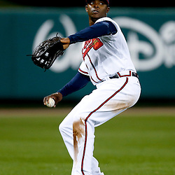 Mar 7, 2013; Lake Buena Vista, FL, USA; Atlanta Braves left fielder Justin Upton (8) fields a ball against the Detroit Tigers during the top of the fifth inning of a spring training game at Champion Stadium. Mandatory Credit: Derick E. Hingle-USA TODAY Sports