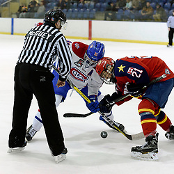 KINGSTON, ON  - FEB 22,  2018: Ontario Junior Hockey League game between the Kingston Voyageurs and the Wellington Dukes. Dawson Ellis #21 of the Wellington Dukes and Brandon Nadeau #91 of the Kingston Voyageurs take the face-off during the first period.<br /> (Photo by Ian Dixon / OJHL Images)