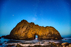 """""""Keyhole Arch, Pfeiffer Beach at Night 2"""" - Photograph of the Milky Way above the Keyhole Arch at Pfeiffer Beach in Big Sur, California."""