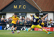 Merstham Midfielder Dan Bennett has a shot on goal during the FA Cup match between Merstham and Oxford United at Moatside, Merstham, United Kingdom on 5 November 2016. Photo by Andy Walter.