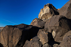 Petroglyphs on ancient volcanic rocks, Petroglyph National Monument, Albuquerque, New Mexico, United States of America