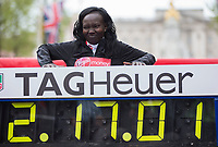 The Women's Race winner Mary Keitany KEN struggles to get up after posing with her world record winning time. The Virgin Money London Marathon, 23rd April 2017.<br /> <br /> Photo: Jed Leicester for Virgin Money London Marathon<br /> <br /> For further information: media@londonmarathonevents.co.uk