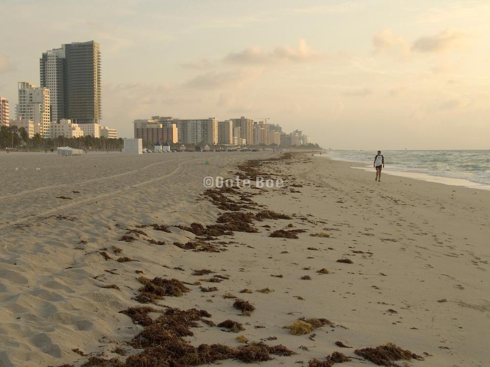 Man enjoying the beach by himself early morning Miami USA