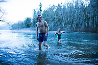 Polar plunge on New Year's Day while nan camping, Olympic Peninsula, Washington.