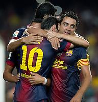 FUSSBALL  INTERNATIONAL  PRIMERA DIVISION  SAISON 2011/2012   23.08.2012 El Clasico  Super Cup 2012 FC Barcelona - Real Madrid  JUBEL Barca; Torschuetze zum 2-1 Lionel Messi (li) umarmt von Xavi Hernandez (re)