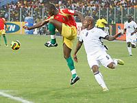 Photo: Steve Bond/Richard Lane Photography.<br />Ghana v Guinea. Africa Cup of Nations. 20/01/2008. Bobo Balde (L) clears in front of Junior Agogo (R)