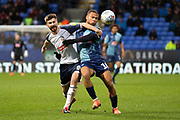 Wycombe Wanderers midfielder Curtis Thompson in al challenge with Bolton Wanderers midfielder Luke Murphy  during the EFL Sky Bet League 1 match between Bolton Wanderers and Wycombe Wanderers at the University of  Bolton Stadium, Bolton, England on 15 February 2020.