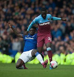 Moise Kean of Everton (L) tackles Arthur Masuaku of West Ham United - Mandatory by-line: Jack Phillips/JMP - 19/10/2019 - FOOTBALL - Goodison Park - Liverpool, England - Everton v West Ham United - English Premier League