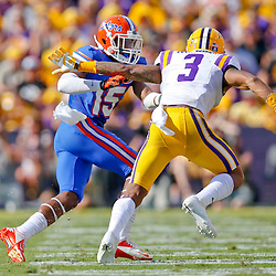 Oct 12, 2013; Baton Rouge, LA, USA; Florida Gators defensive back Loucheiz Purifoy (15) defends against LSU Tigers wide receiver Odell Beckham (3) during the first half of a game at Tiger Stadium. Mandatory Credit: Derick E. Hingle-USA TODAY Sports
