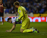 AFC Bournemouth's Artur Boruc and Reading's Jamie Mackie during the Sky Bet Championship match between Reading and Bournemouth at the Madejski Stadium, Reading, England on 14 April 2015. Photo by Mark Davies.