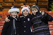 Three festive happy kids at the end - Partick Thistle v Dundee - SPFL Premiership at Dens Park<br /> <br />  - &copy; David Young - www.davidyoungphoto.co.uk - email: davidyoungphoto@gmail.com
