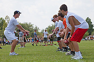 Peyton Manning teaching at the Manning Passing Academy, a family owned football camp where teens learn the fundamentals of football in Thibodaux, Louisiana.