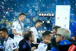 Toni Kroos of Real Madrid and Cristiano Ronaldo of Real Madrid celebrate after they won 3-1 during the UEFA Champions League final football match between Liverpool and Real Madrid and became Champions League  2018 Champions third time in a row at the Olympic Stadium in Kiev, Ukraine on May 26, 2018.Photo by Sandi Fiser / Sportida