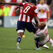 New York Red Bulls player Joel Lindpere (right) tackles Oswaldo Minda, Chivas, USA, during the New York Red Bulls V Chivas USA Major League Soccer match at Red Bull Arena, Harrison, New Jersey, 23rd May 2012. Photo Tim Clayton