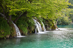 Triple waterfalls, Plitvice Lakes National Park, Croatia. A UNESCO World Heritage site, this natural wonder contains 16 lakes interconnected by rivers and streams. Known for its verdant foliage, numerous waterfalls, and different colored waters, this popular tourist attraction draws more than one million visitors annually.