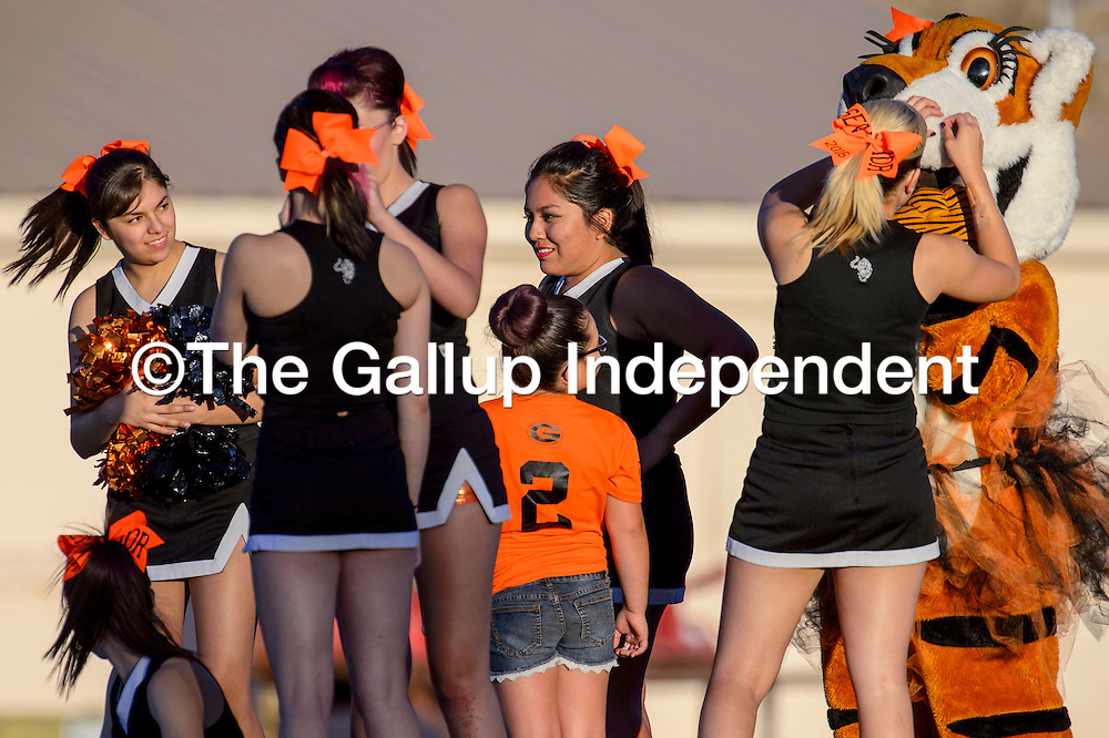 Gallup High School cheerleaders and the Bengal mascot wait to greet the Bengal players Friday at Public School Stadium.