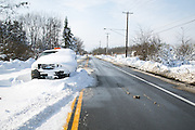 A pickup truck was abandoned on Route 33 in Lancaster, New York, USA on Wednesday, November 19, 2014. Up to six feet of snow fell on the region Tuesday, stranding dozens of motorists on roadways and causing at least six deaths.