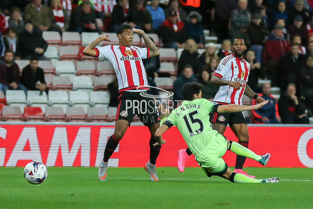 Sunderland defender Patrick Van Aanholt brings down Manchester City midfielder Jesus Navasfor a penalty  during the Capital One Cup match between Sunderland and Manchester City at the Stadium Of Light, Sunderland, England on 22 September 2015. Photo by Simon Davies.