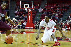 12 February 2011: Austin Hill bounces a pass in front of Jermaine Mallett during an NCAA Missouri Valley Conference basketball game between the Missouri State Bears and the Illinois State Redbirds at Redbird Arena in Normal Illinois.