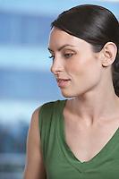 Pensive woman indoors