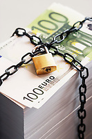 Stack of Euros secured by padlock and chain
