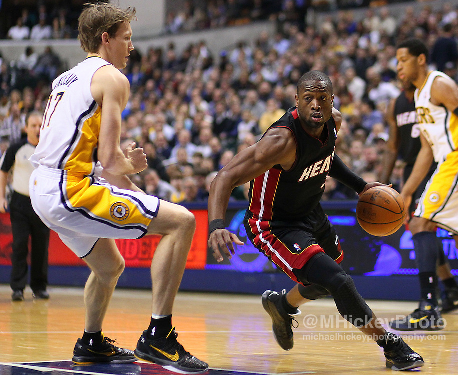 Feb. 15, 2011; Indianapolis, IN, USA; Miami Heat shooting guard Dwyane Wade (3) dribbles to the basket against Indiana Pacers forward Mike Dunleavy (17) at Conseco Fieldhouse. Miami defeated Indiana 110-103. Mandatory credit: Michael Hickey-US PRESSWIRE