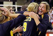 Hannah Peterson (R) of the Dallas Highland Park Scots hugs her teammate Hope Ogdon (#9) after the Scots won their semifinal match against the Austin Lake Travis Cavaliers at the UIL Volleyball State Championships in San Marcos, Texas November 20, 2008.  Highland Park won the match 3-2.