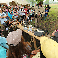 Jim Bishop of Baldwyn shows students the different kinds of weapons that Civil War Cavalry used during the battle at Brice's Crossroads