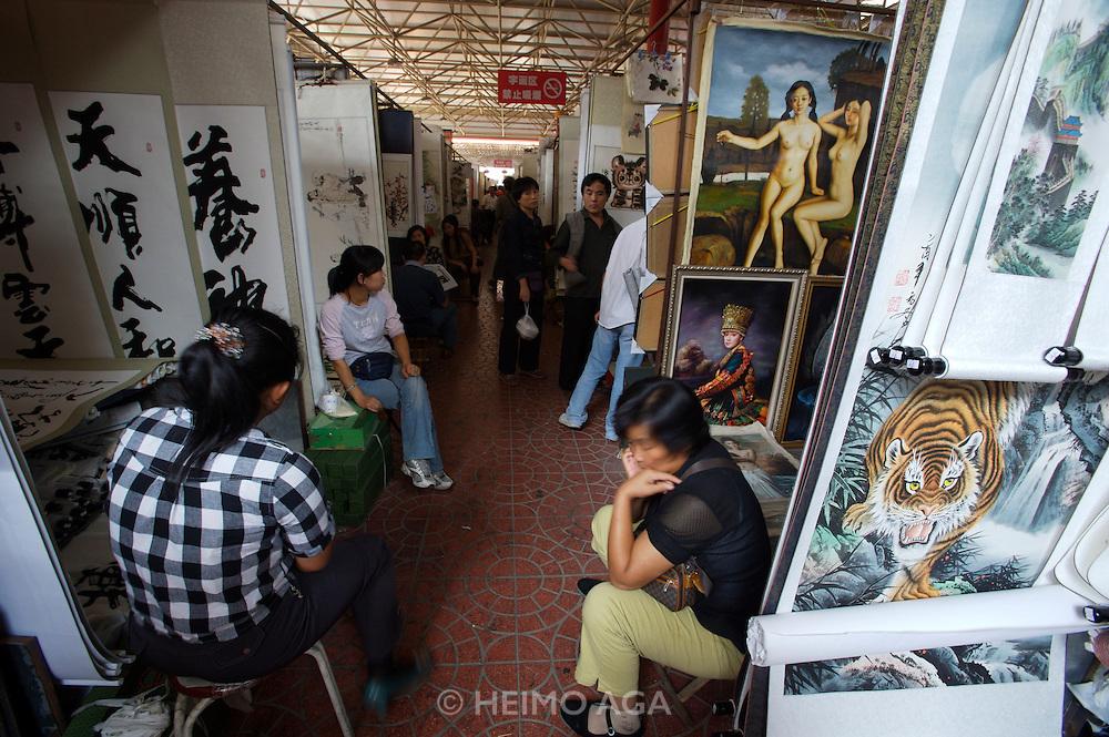 Panjiayuan weekend market. Traditional art galleries selling paintings, drawings, roll paintings etc.