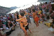 A couple hugging, Sunset beach party, Benirras Beach, Ibiza, July 2006