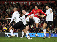 Photo: Paul Thomas/Sportsbeat Images.<br /> Manchester United v Fulham. The FA Barclays Premiership. 03/12/2007.<br /> <br /> Carlos Tevez (Red) of Man Utd battles with Danny Murphy (2nd L), Paul Konchesky (4) and Dejan Stefanovi