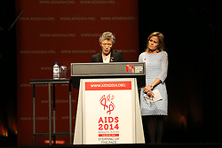 © Licensed to London News Pictures. 20/07/2014. International AIDS Society president Francoise Barre-Sinoussi speaks during the official opening ceremony of the 20th International AIDS conference held in Melbourne Australia on July 20, 2014. This conference takes place a few days after the death of a number of high profile delegates and researchers due to attend whom flew on Malaysian Airlines flight MH17. Photo credit : Asanka Brendon Ratnayake/LNP